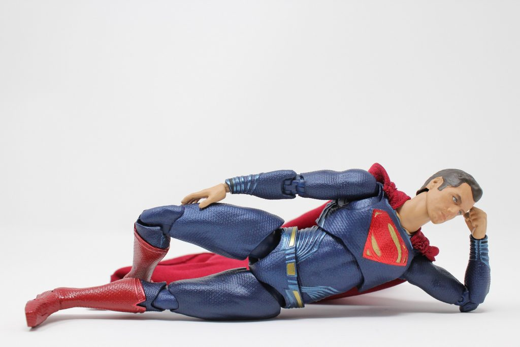 superman lying down resting in strength pose