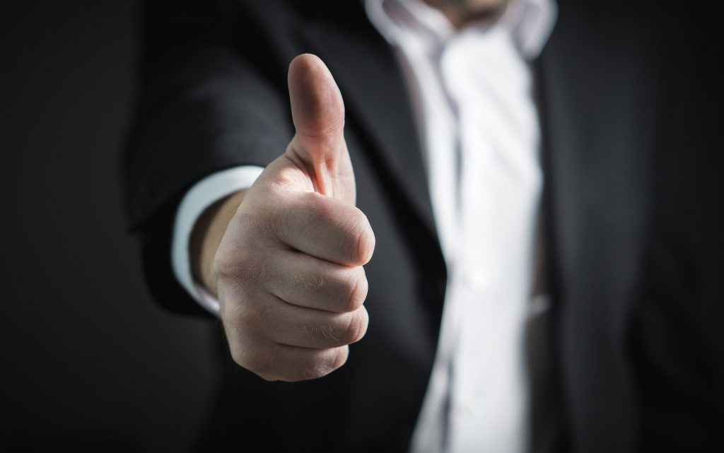 man showing thumbs up to show doing the right thing